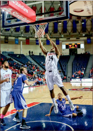 Dunk — Antwan Burrus scored his 1,000th career point against Presbyterian. Photo credit: Courtney Russo