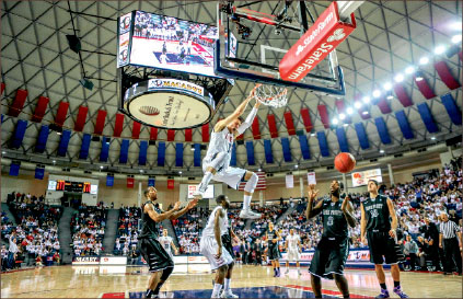 jam — An Andrew Smith dunk electrifies the Vines Center crowd. Photo credit: Courtney Russo