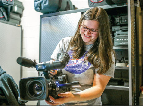 cameras — Students demonstrate how to use some of the updated equipment from the School of Communication & Creative Arts. Photo credit: Leah Stauffer
