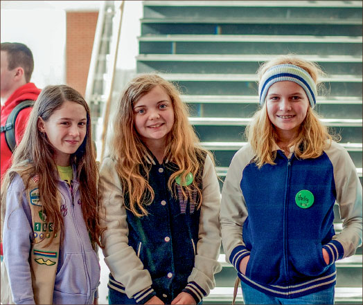 Excited — Girl Scout guests tour the library before settling into cookie­­­-selling classes. Photo credit: Ana Campbell