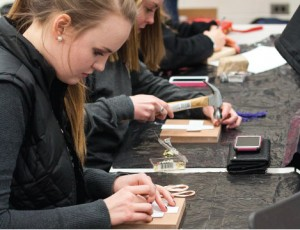 Creative — Students participating in the event used hammers, nails and string to create colorful works of art. Photo credit: Christieanna Apon