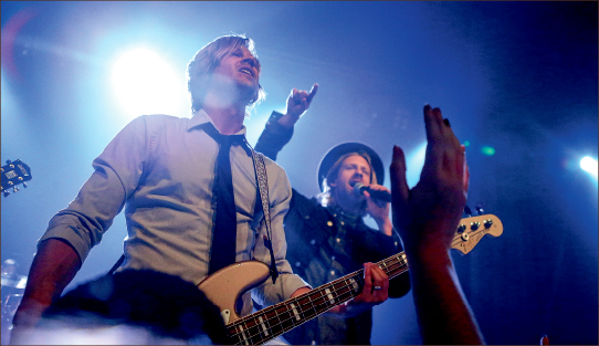 enthusiasm — Switchfoot, led by front man Jon Foreman (wearing hat), brings different styles of music to its concerts. Photo credit: Courtney Russo