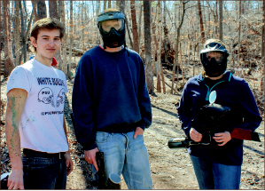 RECREATION — Commuters enjoy a game of paintball in the woods. Photo credit James Ebrahim