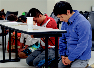 worship — Students from around the world accepted a challenge to pray. Photo credit: Amber Lachniet