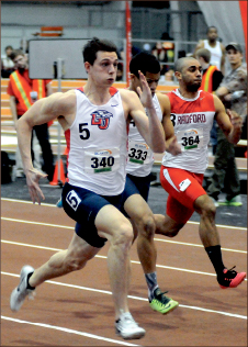 bolt — Freshman Stephen Racanelli finished second in the 200-meter dash. Photo credit: Jamie Hall