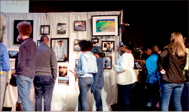PHOtos — This is the first time the art expo has featured photographs from student artists as the main part of the show. Photo credit: Lauren Adriance