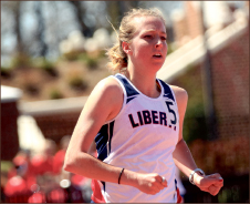 record runs — Liberty broke school records in the 400-meter hurdles and the sprint medley relay. Photo credit: Ruth Bibby