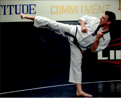 kickstart — Brian Presier practices the art of taekwondo. Photo credit: Lauren Adriance