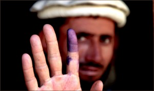 DEVELOPMENT — An Afghanistani voter shows his inked finger to show that he has voted. Google Images
