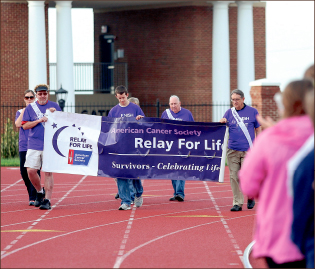 support — Participants walk the Osborne Stadium track over the weekend to raise money for cancer research. Photo credit: Courtney Russo