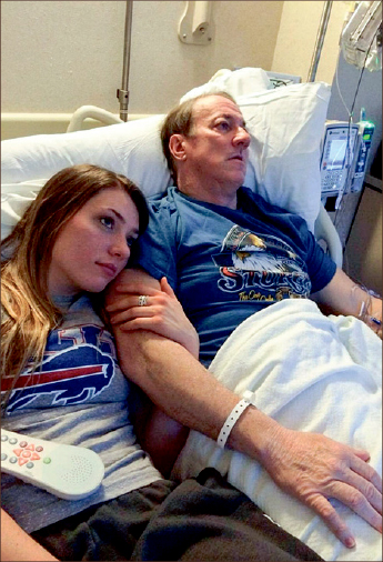 bills pride — Erin Kelly watches television with her father, Bills QB Jim Kelly. Photo provided
