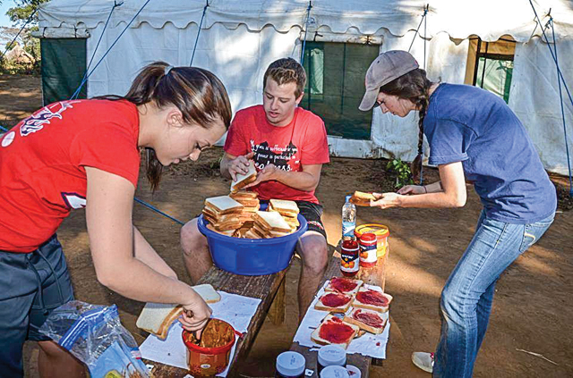 """Students help make lunches for villagers in Zimbabwe."" Photo provided"