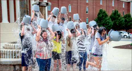 INSPIRATIONAL — The Liberty Champion staff takes the ALS Ice Bucket Challenge in front of DeMoss Hall. Photo credit: Leah Stauffer