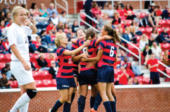 Celebrate — Lady Flames soccer celebrate their victory. Photo credit: Courtney Russo