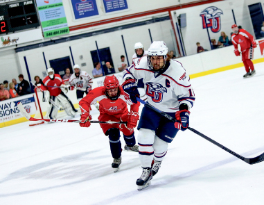 Full speed — Senior captain and defenseman Matt Sherry leads the Flames to the first victory of the 2014-15 season. Photo credit: Courtney Russo