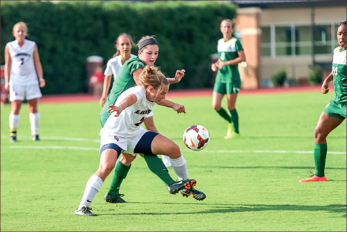 fight — A Lady Flames defender fights for the ball during a very close battle against the Charlotte 49ers. Photo credit: Leah Seavers