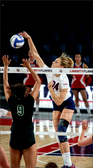 front line — Lady Flames middle blocker Jade Vorster (24) tallied 33 kills in four games during the Liberty Invitational, the first tournament hosted by Liberty since 2011.  Photo credit: Courtney Russo
