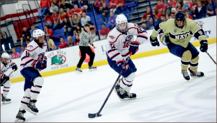 ICE HOT — Freshman Luke Simon (22) notched two goals on the weekend. Photo credit: Courtney Russo