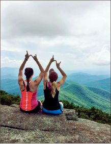 hike — Students relax and enjoy the view . Photo credit: Christieanna Apon