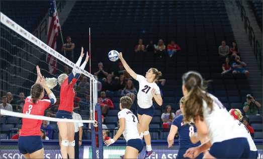 SWAT — Freshman Sirena Vorster (21) had her best game of the season against Radford, tallying a season-high 13 kills in four sets.  Photo credit: Courtney Russo
