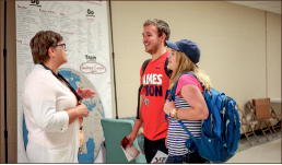 awareness — Students learn about overseas work as they walk through the hallways of DeMoss. Photo credit: Leah Seavers