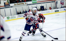 Steady — Senior Cam Bakker (44) controls the puck. Photo credit: Courtney Russo