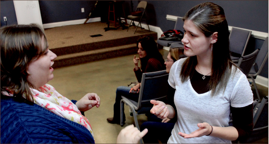 praise — Though they cannot hear, the congregation finds its own unique way to glorify God through a deaf service. Amber Tiller