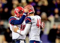 Celebrate — Javan Shashaty (18) and John Lunsford (49) had plenty of reasons to be happy, each playing key roles in the Flames 26-21 playoff victory over James Madison.  Photo credit: Joel coleman