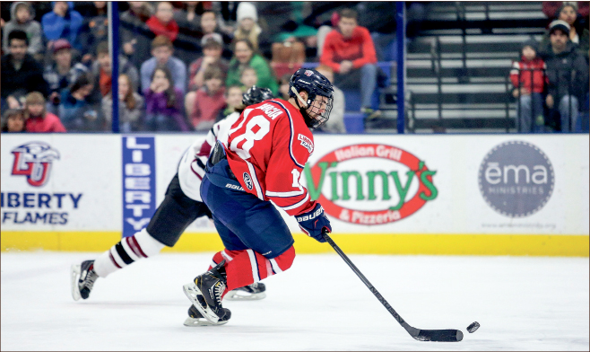 FIRE — Forward Kyle Garcia (18) scored his fifth goal of the season in Liberty's 7-3 win over Rochester in the latter game of their two-game series.  Leah Seavers
