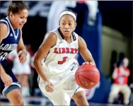 DIMES — Sadalia Ellis dished out seven assists against Longwood.  Photo credit: Courtney Russo