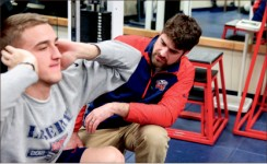 Examine — Trainer Aaron Schreiner works to rehabilitate injured players. Photo credit: Courtney Russo