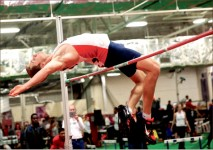hiGH flyer — Senior Kyle Wheeler clears the bar on his way to victory in the men's high jump.  Photo credit: Courtney Russo