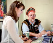 INTERNATIONAL — Student mingles with representative. Photo credit: Leah Seavers