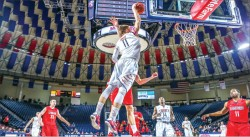 POSTERIZE — Forward Andrew Smith played one of his best games of the season against Radford, finishing with 20 points and 10 rebounds to go along with two blocked shots.  Photo credit: Leah Seavers