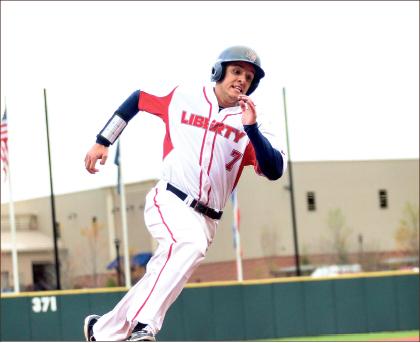Hustle — Third baseman Sammy Taormina rounds the bases against Maryland. Photo credit: Courtney Russo