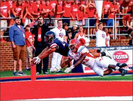 touchdown —  Desmond Rice dives for the end zone. Photo credit: Leah Seavers