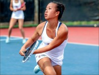 backhand — Senior Valerie Thong , one of only two seniors for the Lady Flames, zoned in on her opponent. Photo credit: Leah Seavers
