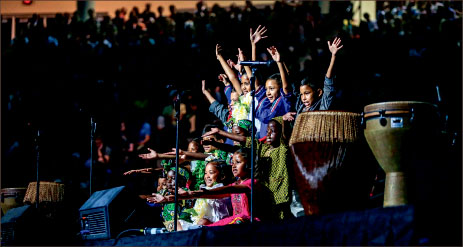 Dance — The Children of the World choir brought smiles to faces at Convocation. Photo credit: Leah Seavers