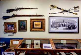 Antiques — Photographs, guns and swords were displayed in the museum. Photo credit: Kallie Britton