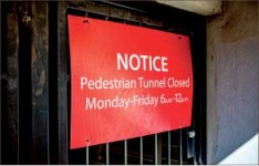 Posted — Signs informed pedestrians of the tunnel closure Monday-Friday. Photo credit: Michela Diddle