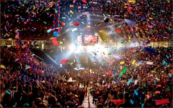 Celebrate — Confetti came down in the Vines Center during Winterfest 2014. Photo credit: James Hancock
