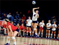 Get up — Lady Flames sophomore Lindsay Foreman sends a serve over the net during a home game. Photo credit: Leah Seavers