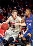 COntested — Ryan Kemrite looks to drive to the basket against Presbyterian's Ed Drew.  Photo credit: Leah Seavers
