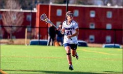 Moving Up — Captain Kallie Britton leads the Lady Flames forward. Photo credit: Courtney Wheeler