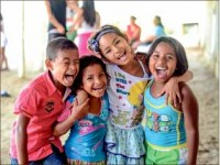 HOPE — Children from an internal displaced community in Colombia pose. Photo provided