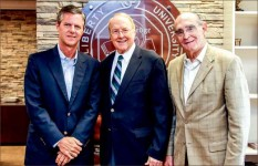 Partners — Dr. James Dobson is pictured with President Jerry Falwell (left) and former provost Dr. Ronald Hawkins (right). Photo credit: David Duncan