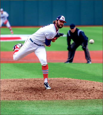 Pitch — Right-handed pitcher Carson Herndon earned the win against UConn. Photo credit: Leah Seavers