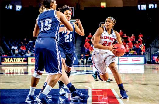 Side step — Sophomore guard Sheana Vega drives through the lane during the Lady Flames blowout victory over Longwood. Photo credit: Michela Diddle