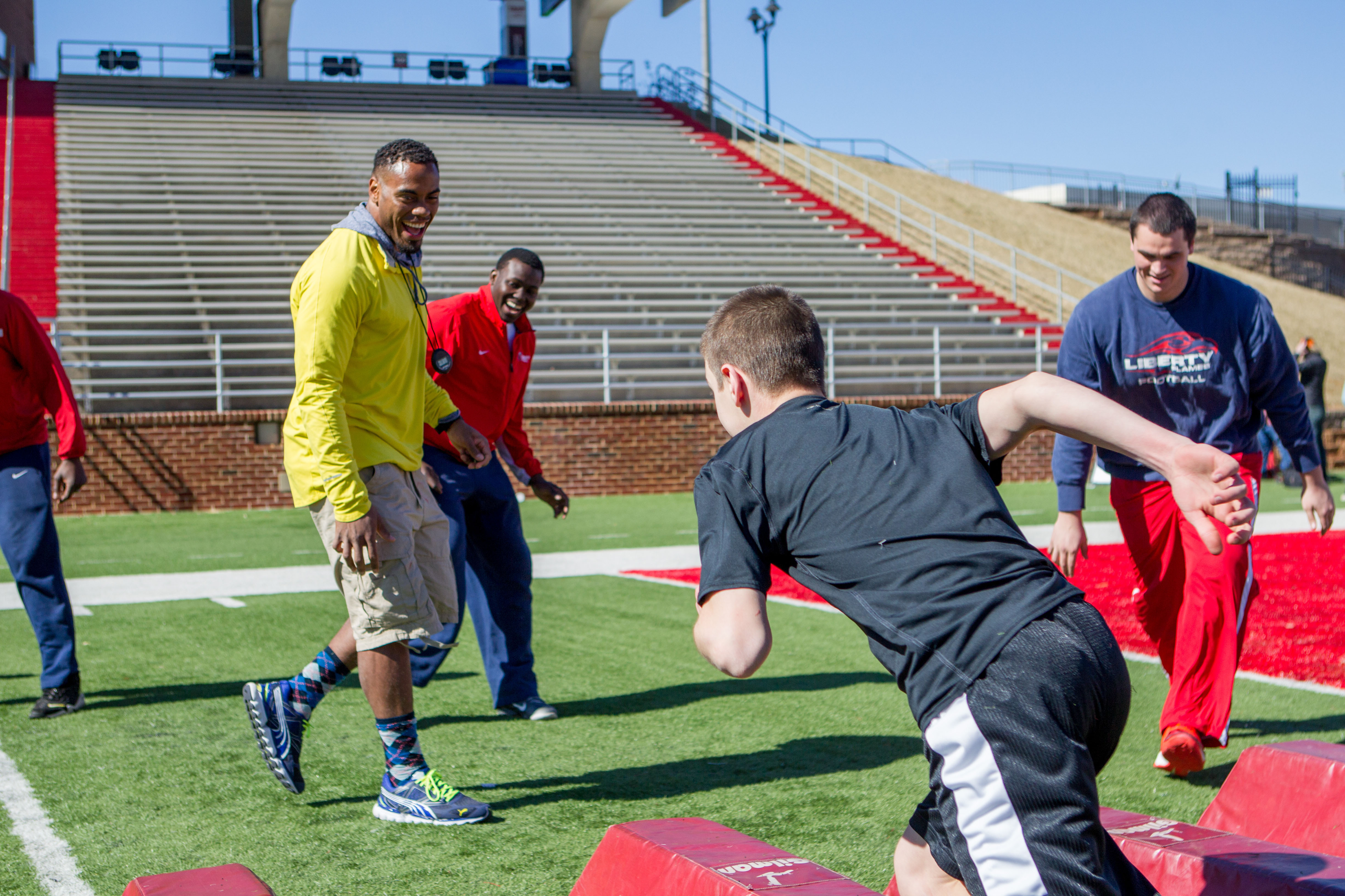Rashad Jennings and Mike Brown hold a camp at Williams Stadium on February 22, 2013. (Photo by Kevin Manguiob)