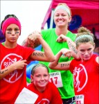 Strength— Runners wrote the names of human trafficking victims on their arms while they raced. Photo credit: Sam Chappell